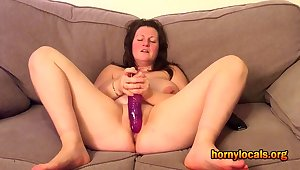 Busty MILF Carrying-on here her Purple Dildo