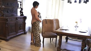 Mature lady makes leopard print attire look sexy and she masturbates oft-times