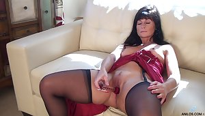 Foxy matured Lelani Tizzie drops her dress hither have some solo recreation