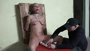 Gagged blonde endures ruthless maledom on cam
